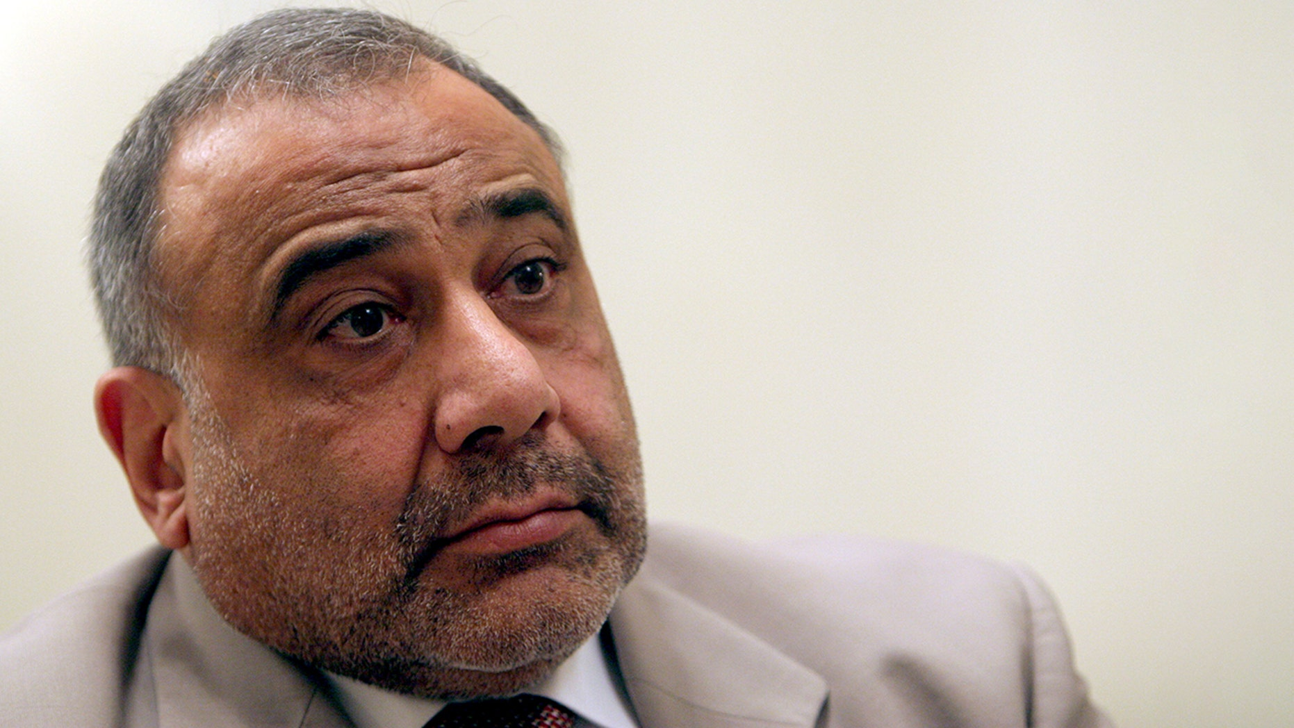 In this Jan. 3, 2006 file photo, Iraq's vice president Adel Abdul-Mahdi is seen during an interview with The Associated Press in Baghdad, Iraq. (AP Photo/Khalid Mohammed, File)