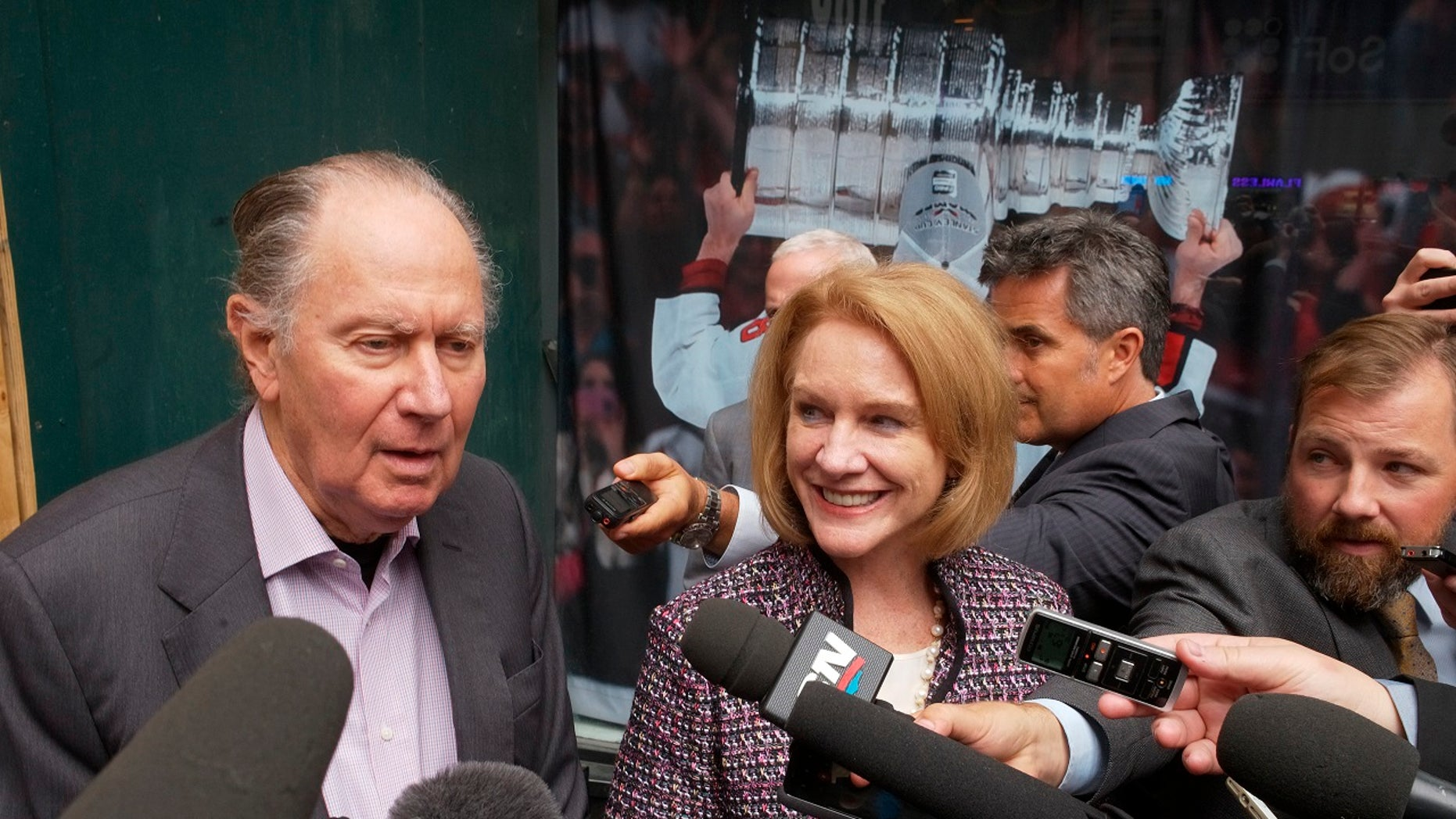 David Bonderman, left, of Seattle Hockey Partners, and Seattle Mayor Jenny Durkan talk to reporters as they leave a meeting at National Hockey League headquarters in New York City, Oct. 2, 2018.