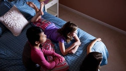 A new study has researchers calling for stricter recommendations on screen time for kids following evidence that suggests watching only an hour of TV a day is linked to an unhealthy weight.