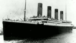 Why did the Titanic's eight musicians continue to play on the deck even as the ship was going down?