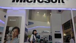 China took its investigation of alleged monopoly actions by Microsoft to a new level this week, raiding four of the company's offices and carrying away internal documents and computers.