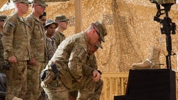 The men here can be seen saluting senior officers, while saying, Sir, with your shield or on it. This is the mantra of Task Force Spartan.