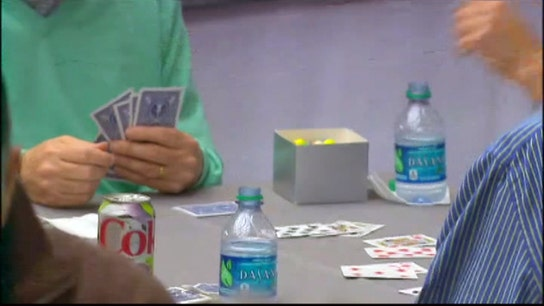 Buffett, Gates compete in a game of bridge