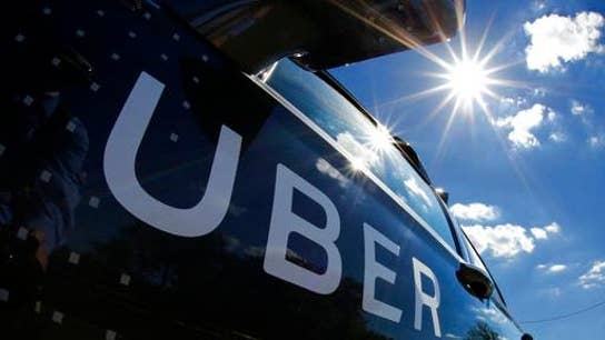 Uber posts $1B loss, matching projections in first earnings report as public company