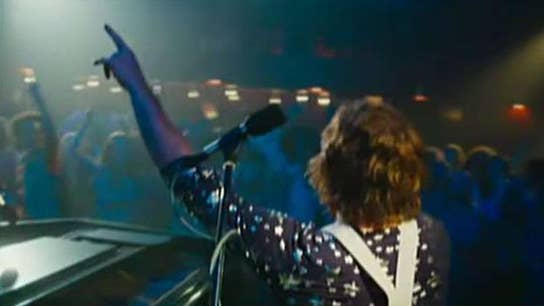 Elton John biopic rockets into theaters