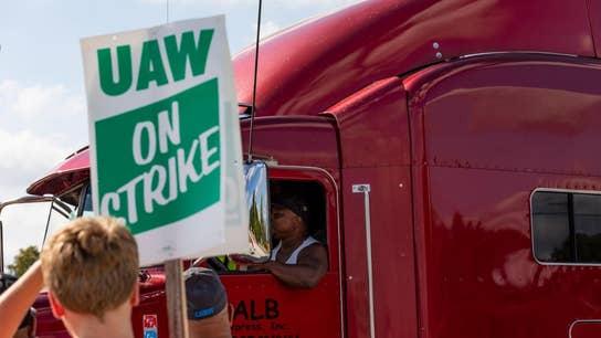 GM drops strikers' health benefits