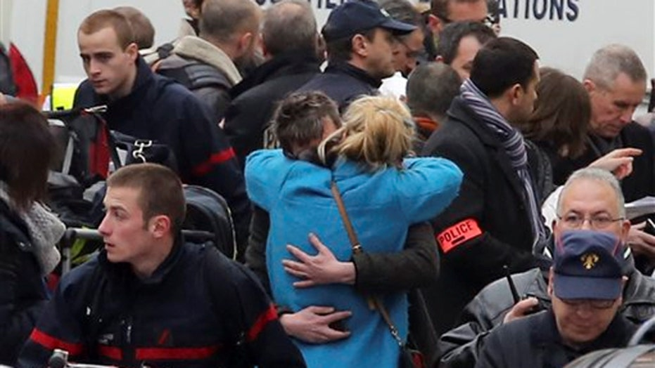 Gunmen storm office of satirical magazine in Paris