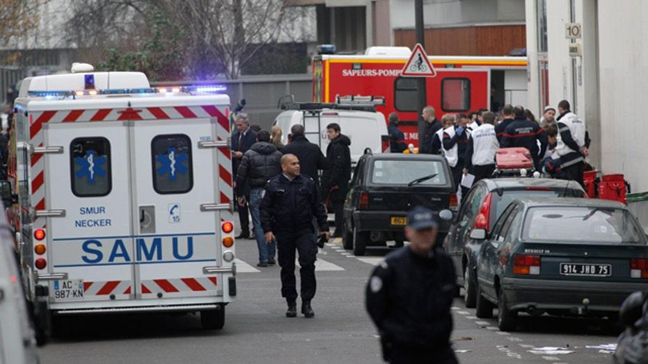 Gunmen in Paris terror attack still at large