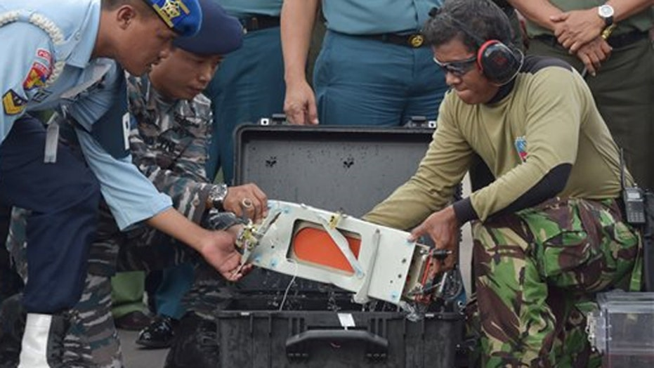Divers locate the black boxes from AirAsia flight 8501