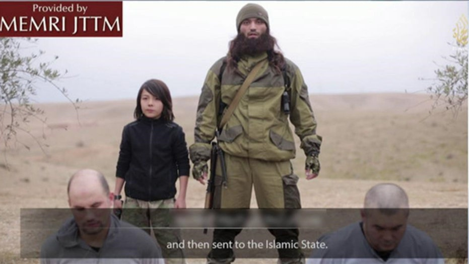New ISIS video shows young boy executing prisoners