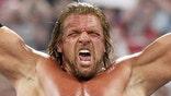 Triple H makes little boy cry