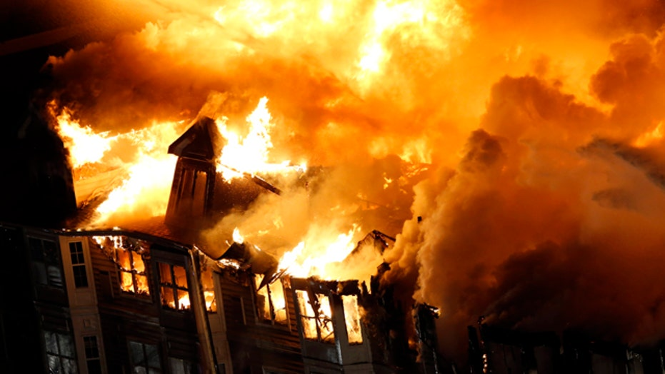 Massive blaze tears through luxury apartment complex