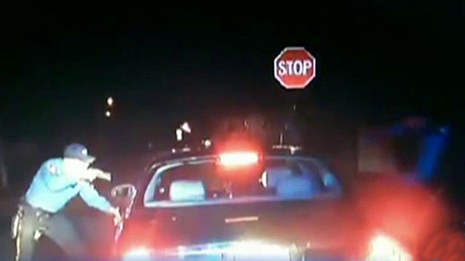 Police officers shoot man with hands up