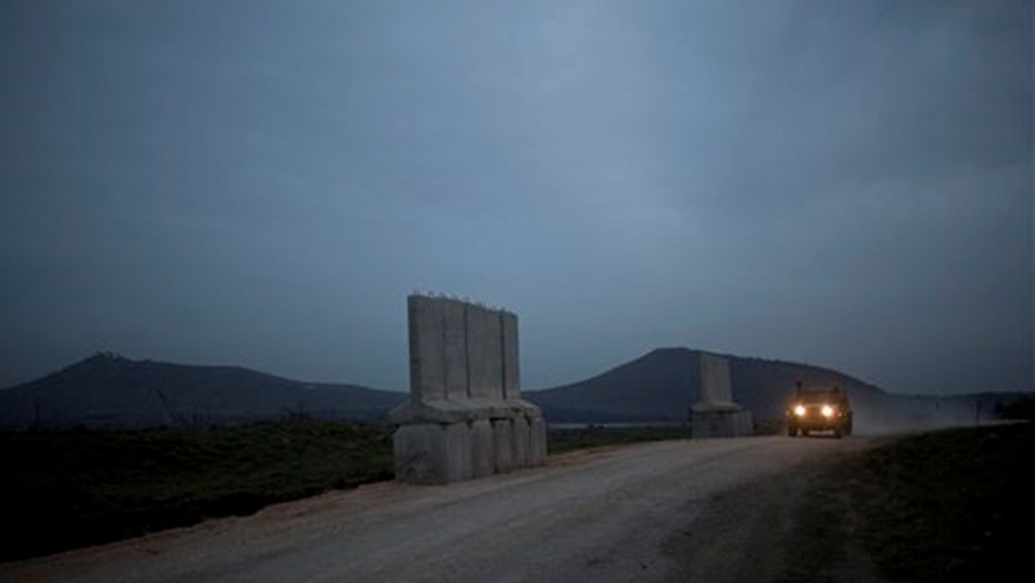 Israel says rockets from Syria hit the Golan Heights