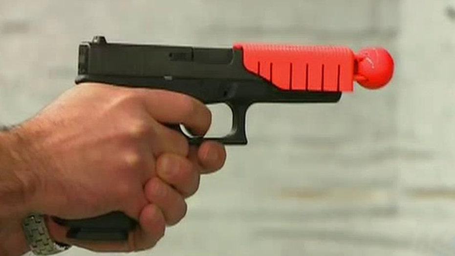 Ferguson cops to train with less fatal weapons