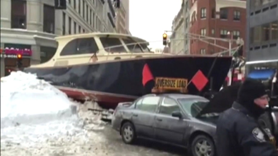 Yacht stuck in snow snarls Boston traffic