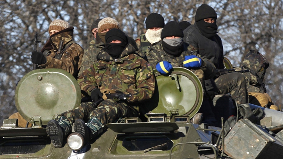 Ukraine troops retreat as rebel continue to attack key city