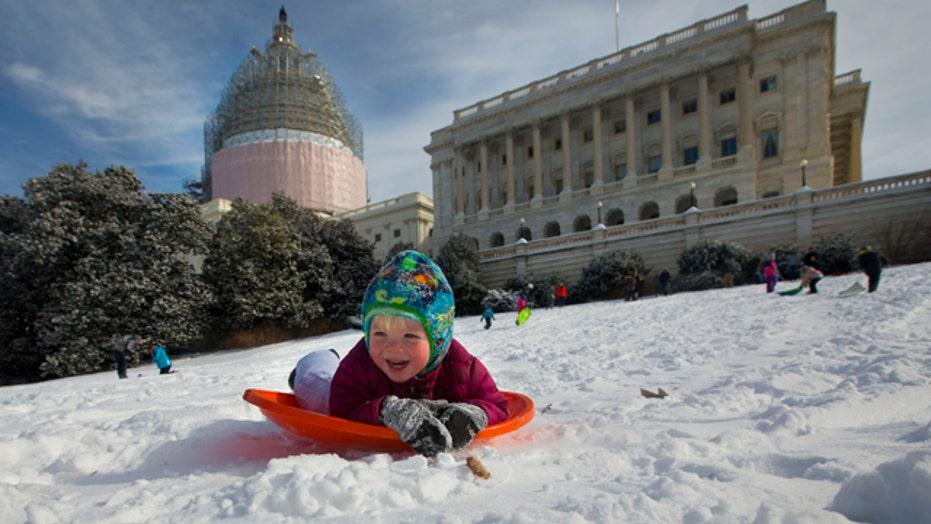 Sledding showdown on snowy Capitol Hill