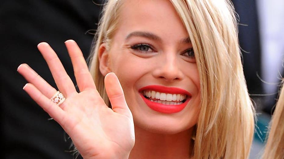 'Focus' star Margot Robbie has sticky fingers