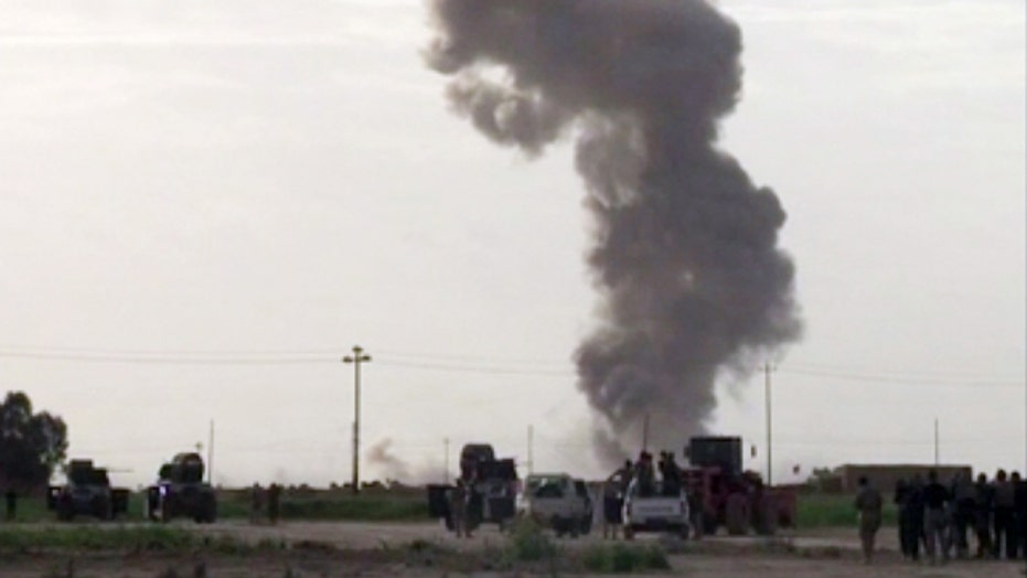 Iranian forces aid Iraqi troops in battle over Tikrit