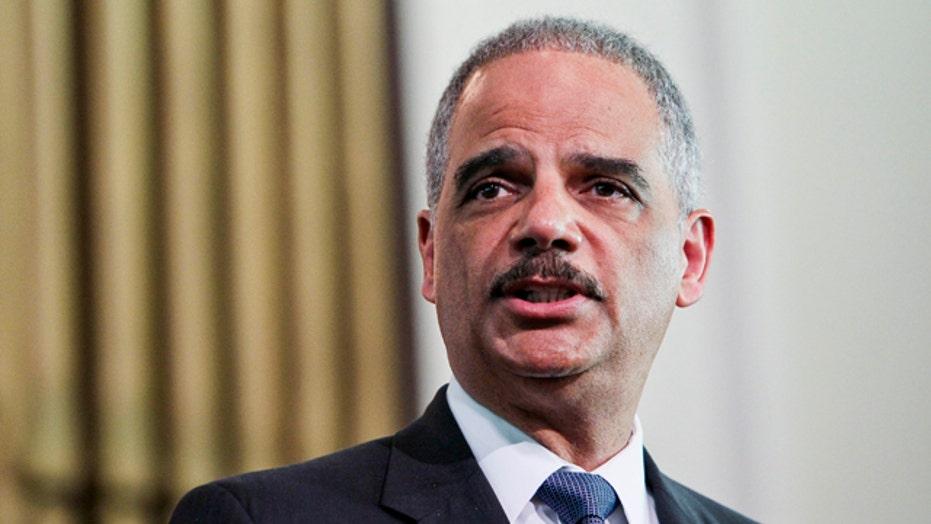 Holder prepared to 'dismantle' Ferguson police department