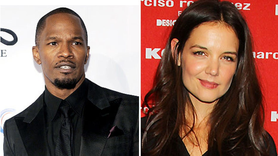 Katie Holmes and Jamie Foxx sitting in a tree?