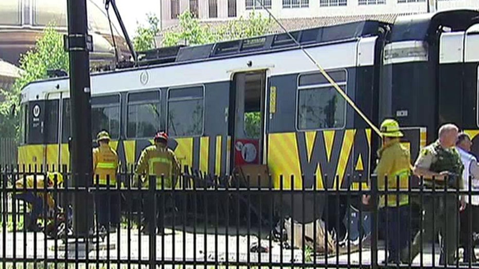 More than 20 injured after commuter train collides into car