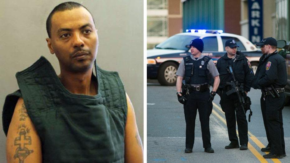Prisoner escapes Virginia hospital with security guard's gun