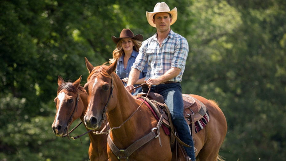 Eastwood and Robertson buckle up for 'The Longest Ride'
