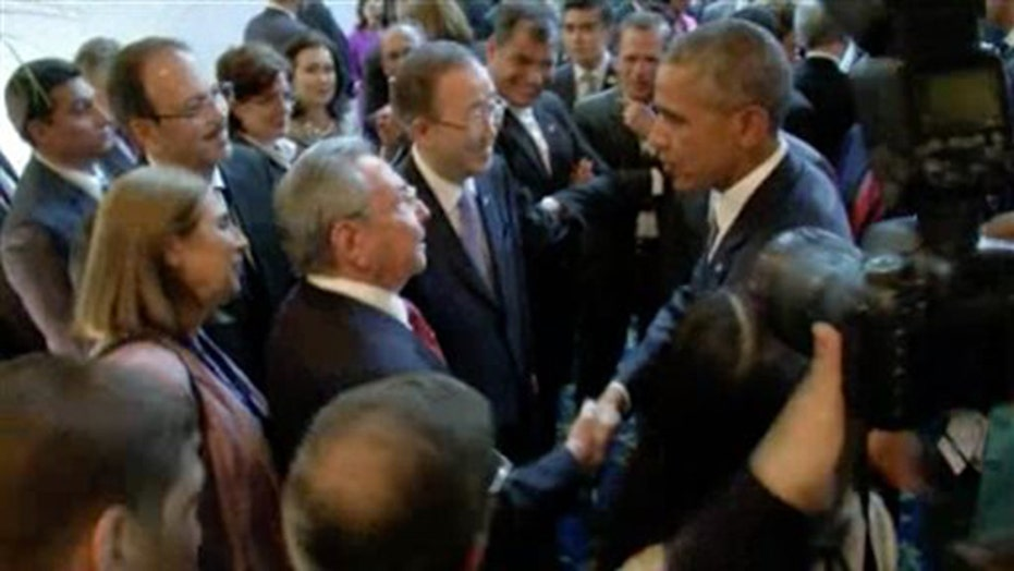 Obama and Cuban Pres. Raul Castro shake hands in Panama