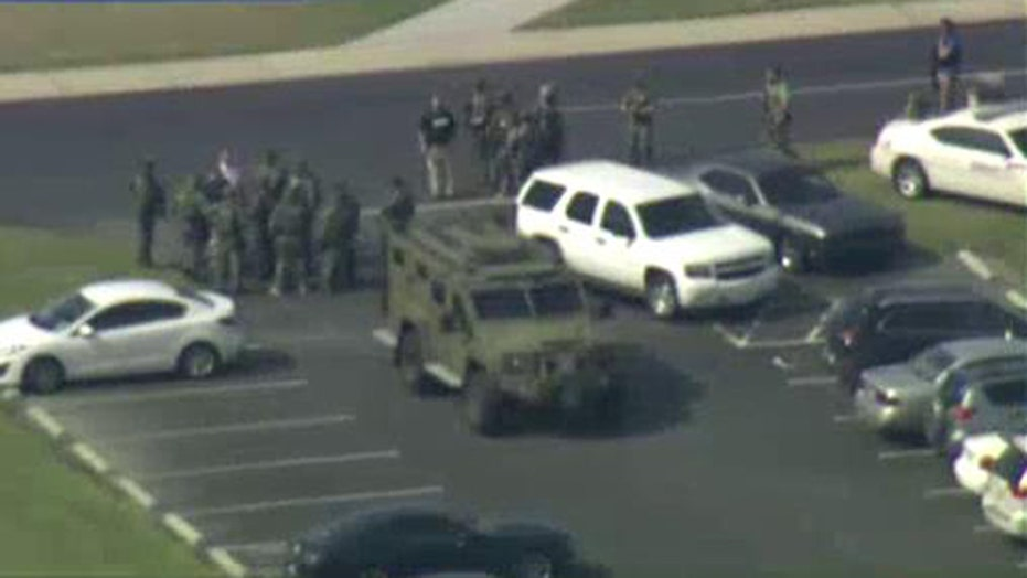 Report: 1 dead, shooter at large at NC community college