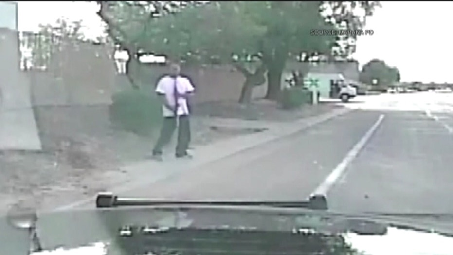 Police officer runs down robbery suspect with squad car