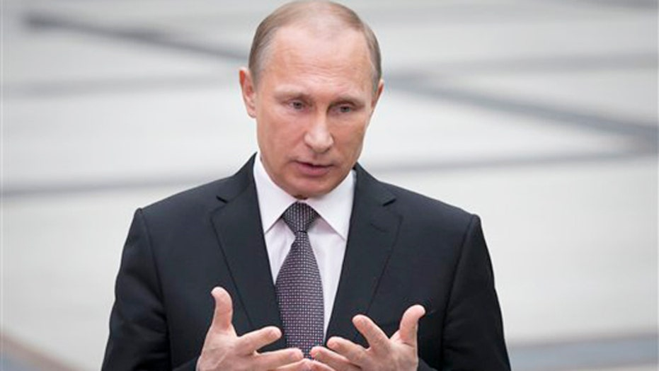 Putin defends sale of missile defense system to Iran