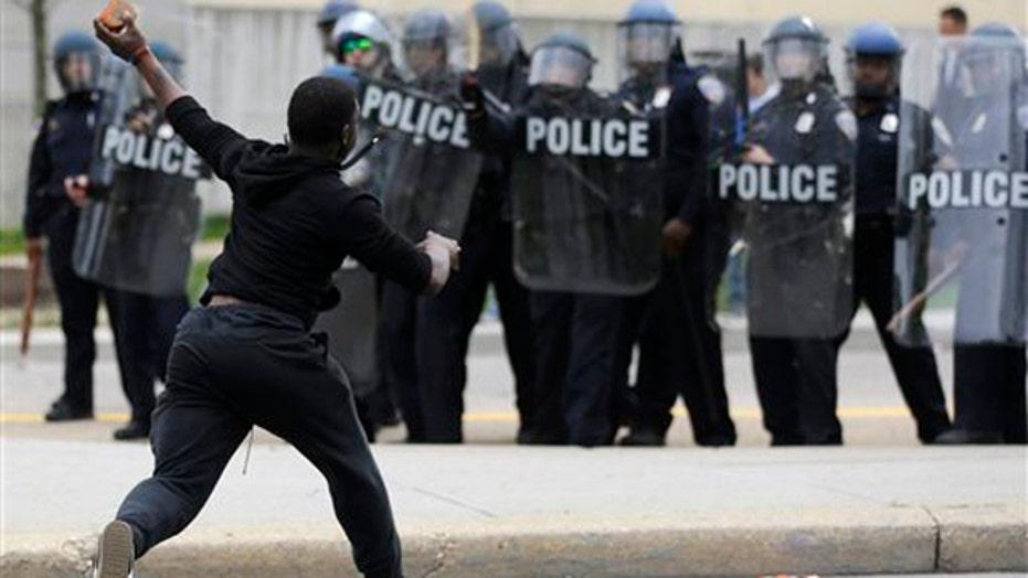 Riots erupt in Baltimore, despite call for calm
