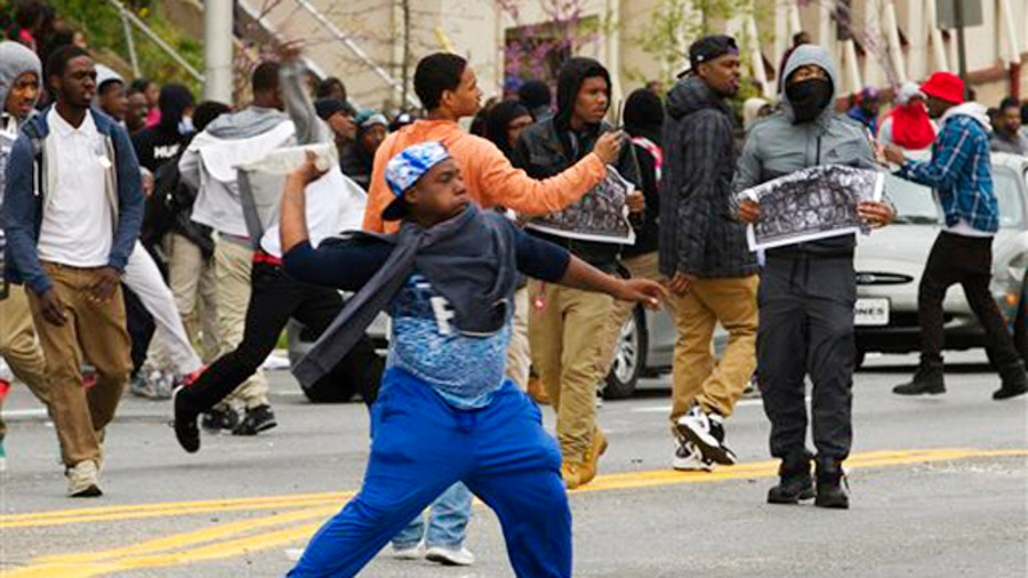 Protesters throwing rocks, bottles at police in Baltimore