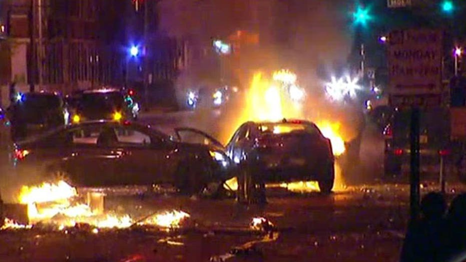 Police attempt to restore order in Baltimore amid riots