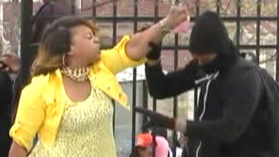 Baltimore mom smacks son for throwing rocks at police