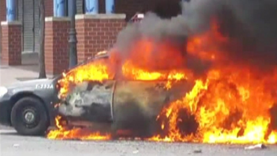 Police squad car burns amid Baltimore rioting