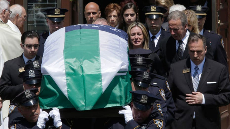 Thousands of cops gather for funeral of NYPD officer
