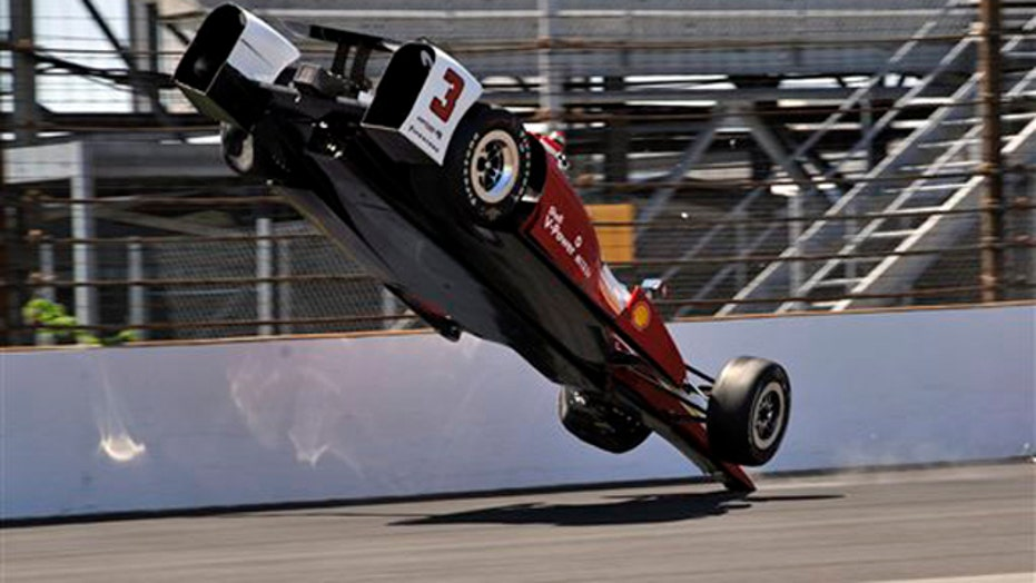 Helio Castroneves' IndyCar goes airborne in scary crash