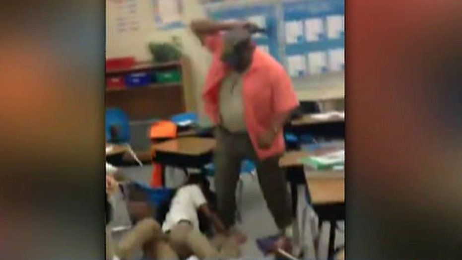 Teacher caught on tape whipping students with belt