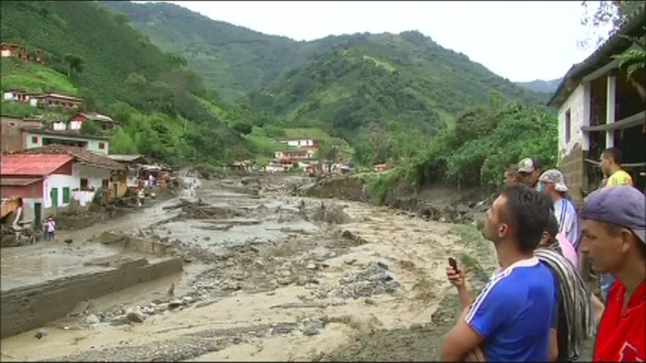 Mudslide sweeps away homes, dozens killed in Colombia