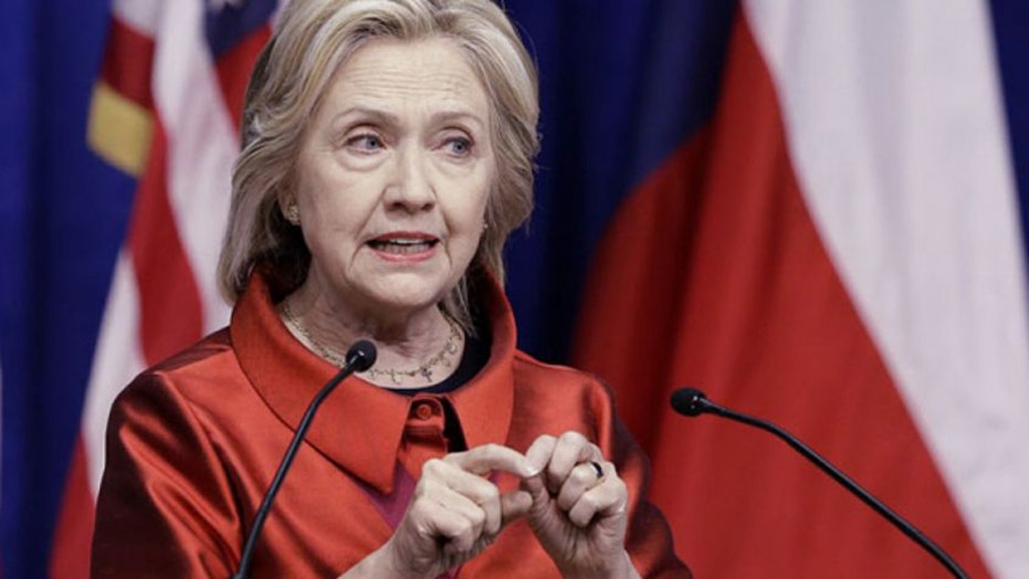 Clinton accuses Republicans of trying to curb voting rights