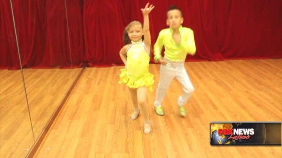 Cute salsa champs give it their all on the dance floor