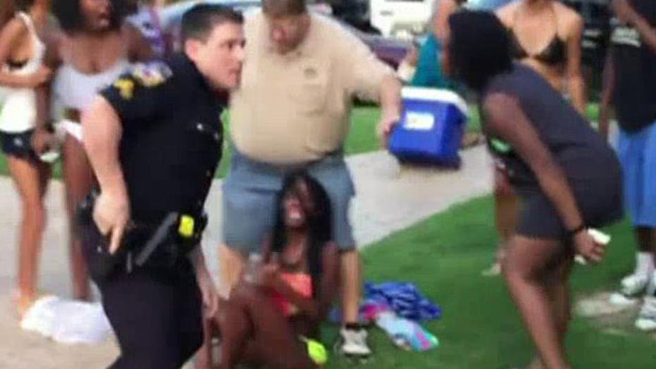 Video shows Texas police officer pulling guns on teens