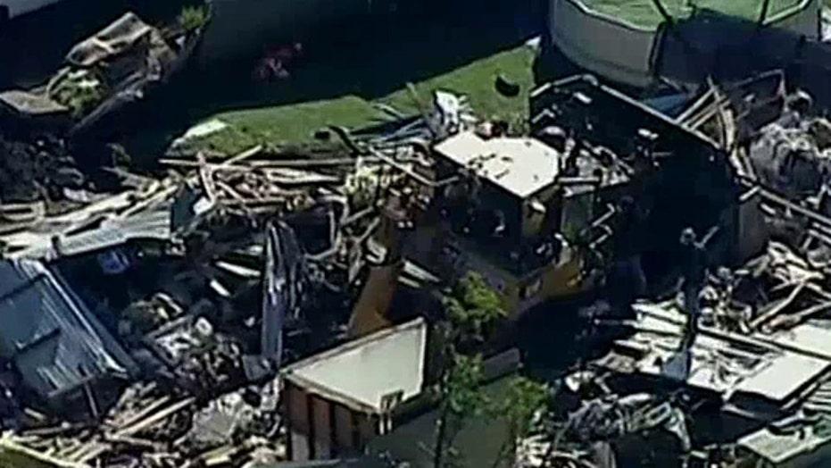 Stolen bulldozer plows into Australian family's home