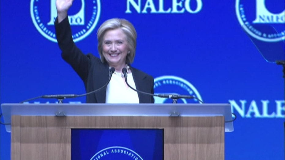Clinton says she'd go farther than Obama on immigration