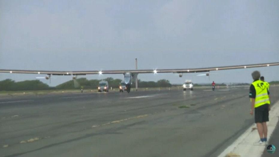 Solar-powered plane lands in Hawaii after flight from Japan