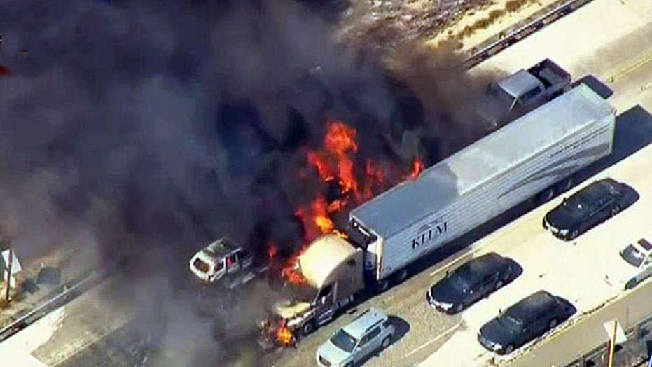 Brush fire engulfs California highway, sets cars ablaze