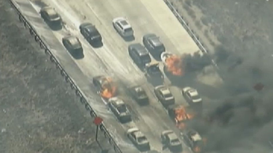 Wildfire sweeps across California freeway